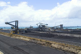 Mining Photo Stock Library - wide panorama shot of coal terminal.  plenty of reclaimers and loaders.  long wharf out to ships being loaded  and ocean in background. great production coal panorama image. ( Weight: 1  New Image: NO)