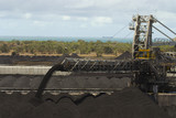 Mining Photo Stock Library - coal pouring off the end of a reclaimer conveyor onto a stockpile at shipping terminal. ( Weight: 3  New Image: NO)
