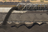 Mining Photo Stock Library - close up of coal falling off a conveyor and being stockpiled.  lots of stockpiles in background.  great generic coal production image. ( Weight: 1  New Image: NO)