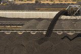 Mining Photo Stock Library - close up of coal falling off a conveyor and being stockpiled.  lots of stockpiles in background.  great generic coal production image. ( Weight: 2  New Image: NO)