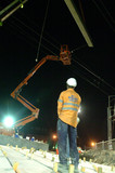 Mining Photo Stock Library - construction worker on infrastructure site with overhead travel tower and crane lifting steel beams. ( Weight: 4  New Image: NO)