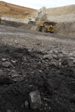 Mining Photo Stock Library - close up of coal in open cut coal mine with wide dramatic background to out of focus haul truck and digger.  vertical image. ( Weight: 1  New Image: NO)