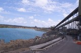 Mining Photo Stock Library - conveyor at coal terminal passing next to ocean and site fence. ( Weight: 4  New Image: NO)