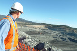 Mining Photo Stock Library - mine site engineer in full ppe looking out over open cut coal mine from high point. ( Weight: 1  New Image: NO)