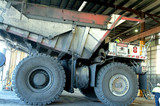 Mining Photo Stock Library - haul truck in maintenance workshop with workers. ( Weight: 4  New Image: NO)