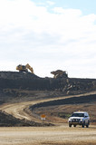 Mining Photo Stock Library - light vehicle driving haul road with excavator and haul truck. ( Weight: 3  New Image: NO)