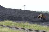 Mining Photo Stock Library - bulldozer stockpiliong coal with rail lines in foreground.  green environment rehabilition in foreground. ( Weight: 3  New Image: NO)