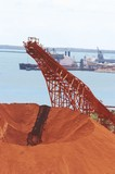 Mining Photo Stock Library - bauxite stockpile with loader and ship wharf in background. ( Weight: 3  New Image: NO)