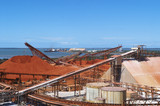 Mining Photo Stock Library - bauxite stockpiles at alumina proecssing plant.  shipping and wharves in background. ( Weight: 1  New Image: NO)
