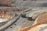 Mining Photo Stock Library - loaded haul truck passes empty truck on circuit at open cut gold mine. light vehicles follow. ( Weight: 1  New Image: NO)