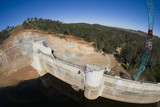 Mining Photo Stock Library - Construction of a dam. Aerial shot from crane bucket. ( Weight: 1  New Image: NO)