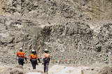 Mining Photo Stock Library - three 3 mine workers walking in full PPE along pit floor of open cut gold mine. ( Weight: 1  New Image: NO)