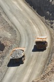 Mining Photo Stock Library - aerial, vertical shot of loaded haul trucks passing on gold haul road. ( Weight: 1  New Image: NO)