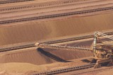 Mining Photo Stock Library - close up aerial shot of iron ore reclaimer working at shipping terminal.  this shot shows the scale of the machinery. ( Weight: 1  New Image: NO)