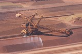 Mining Photo Stock Library - iron ore reclaimer working at ship terminal. water sprayer for dust suppression with light vehicle adjacent for scale. ( Weight: 1  New Image: NO)