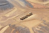 Mining Photo Stock Library - 6 six trucks and water cart parked up at the go line on open cut mine site.  aerial shot. ( Weight: 1  New Image: NO)