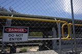 Mining Photo Stock Library - covered coal conveyor behind wire fence with do not enter sign posted. ( Weight: 1  New Image: NO)