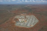 Mining Photo Stock Library - high aerial shot of 3000 person mine camp.  there is wilderness in background way back to horizon.  ( Weight: 1  New Image: NO)