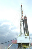 Mining Photo Stock Library - oil and gas drill rig in afternoon thunderstorm. ( Weight: 1  New Image: NO)