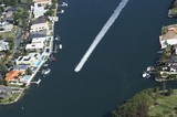Mining Photo Stock Library - aerial shot of jetski or small water craft on canal with residential houses all around. ( Weight: 1  New Image: NO)