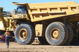 Mining Photo Stock Library - mine worker in full PPE walks to parked up haul truck. ( Weight: 1  New Image: NO)
