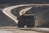 Mining Photo Stock Library - loaded haul truck moving on haul road in open cut mine. dark exposure to capture flashing LED green lights on front to show its loaded. ( Weight: 1  New Image: NO)
