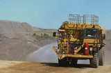 Mining Photo Stock Library - water truck spraying for dust suppression on haul road at open cut coal mine. ( Weight: 1  New Image: NO)
