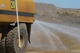 Mining Photo Stock Library - close up of water truck spraying water for dust suppression on haul road at open cut mine. ( Weight: 1  New Image: NO)