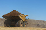 Mining Photo Stock Library - loaded haul truck with overburden heads to stockpile in open cut mine.  clear blue sky with plenty of space for copy. ( Weight: 1  New Image: NO)