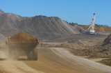 Mining Photo Stock Library - loaded haul truck from open cut mine travels on haul road past drag line. ( Weight: 1  New Image: NO)