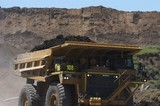 Mining Photo Stock Library - loaded haul truck in open cut mine carrying over burden with high stockpiles behind. ( Weight: 1  New Image: NO)