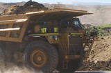 Mining Photo Stock Library - loaded haul truck in open cut mine hauling overburden to stockpile.  green LED lights on front. ( Weight: 1  New Image: NO)