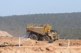 Mining Photo Stock Library - water cart in open cut mine spraying for dust suppression. ( Weight: 1  New Image: NO)