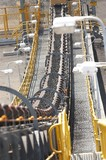 Mining Photo Stock Library - Conveyor loaded with coal in open cut coal mine.  close up vertical shot. ( Weight: 1  New Image: NO)