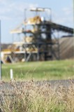 Mining Photo Stock Library - great generic shot of coal wash plant  at open cut mine.  grass plants in foreground in focus with green grass in middle ground. ( Weight: 1  New Image: NO)