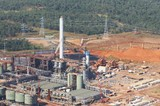 Mining Photo Stock Library - aerial shot of bauxite alumina refinery.  bauxite stockpiles in background.  giant processing plant. ( Weight: 1  New Image: NO)