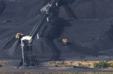 Mining Photo Stock Library - close up aerial photo of tractors stockpiling coal at shipping terminal.  conveyor working above to spread coal. ( Weight: 1  New Image: NO)