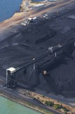 Mining Photo Stock Library - vertical aerial photo of tractors stockpiling coal at shipping terminal.  conveyor working above to spread coal. ( Weight: 1  New Image: NO)