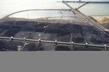 Mining Photo Stock Library - aerial photo of stockpiled coal at shipping terminal with conveyors, loaders and large ship wharf in background. ( Weight: 1  New Image: NO)