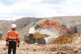 Mining Photo Stock Library - male worker in full PPE observing haul truck being loaded with overburden by excavator in open cut mine. ( Weight: 1  New Image: NO)