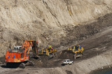 Mining Photo Stock Library - EX2500 excavator with 2 two dozers and light vehicle in open cut coal mine.  haul access road and mine water storage in shot. ( Weight: 1  New Image: NO)