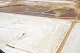Mining Photo Stock Library - aerial photo of multi trailer haul truck being loaded in salt plains. wide shot. ( Weight: 1  New Image: NO)