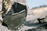 Mining Photo Stock Library - close up shot of coal in an excavator bucket with haul truck on road in background.  open cut coal mining. ( Weight: 1  New Image: NO)