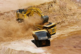 Mining Photo Stock Library - Close up photo of excavator loading overburden into haul truck. ( Weight: 1  New Image: NO)