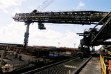Mining Photo Stock Library - close up photo of a ship loader loading coal at a terminal ( Weight: 1  New Image: NO)
