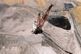 Mining Photo Stock Library - aerial photo of dragline working in open cut coal mine.  coal seams and high walls clearly visible.  digger and truck rotation shifting coal in background. ( Weight: 1  New Image: NO)