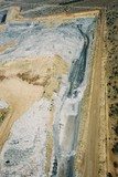 Mining Photo Stock Library - aerial photo of overburden stock piling in open cut coal mine.  excavator and truck rotation and dragline in background. mine access haul roads adjacent. ( Weight: 1  New Image: NO)
