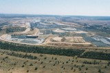 Mining Photo Stock Library - great wide aerial shot of open cut coal mine.  cldarly see stockpiling of overburden, truck and digger rotation, dragline, rehabilitation and mine high walls. ( Weight: 1  New Image: NO)