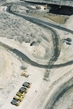 Mining Photo Stock Library - vertical aerial photo of haul trucks at the go line in open cut coal mine.  excavator loading coal in background. ( Weight: 1  New Image: NO)