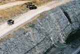 Mining Photo Stock Library - great aerial phot of haul trucks on access road above coal seam high walls.